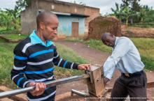 Handpump mechanics, Baluku Ramathan and Balyebuga Steven, working in Kabarole district, Uganda
