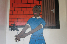 Painting on a school depicting a girl washing her hands