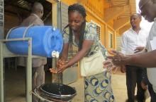 Burkina Faso: woman washing her hands