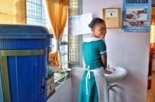 Girl washing hands in Ghana