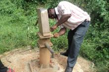 A hand pump mechanic at work in Kabarole District, Uganda