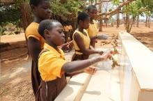 Schoolgirls washing hands