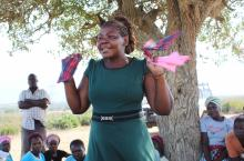 Bulandina Tatu demonstrates the making of reusable menstrual pads by women in Batani village, Kwale County, Kenya