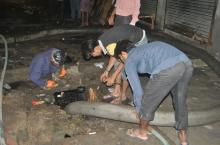 Cleaning a manhole in India