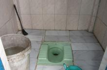 Toilet with cleaning materials
