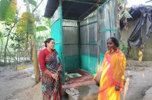 Checking a household latrine in Bangladesh