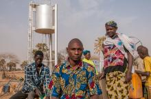 People in front of a water tank - Sahel, Burkina Faso