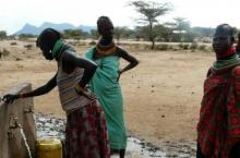 Kenyan women collecting water at standpipe - Kenya Arid Lands Disaster Risk Reduction (KALDRR) WASH project