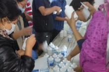 Local environmental NGO ENPHO mobilises youth volunteers to distribute Piyush water disinfectant. Photo: Srijana Karki / ENPHO