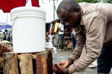 Washing hands at a market