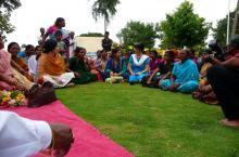 Indian ladies sitting in a circle