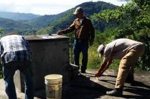 Municipal technician checking storage tank