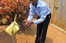 Using a tippy tap in Rwanda