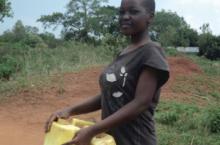 Woman fetching water in Uganda