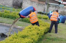 Kabarole district hand pump mechanics disposing waste safely.