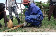 Professional mechanic repairs village handpump in Uganda