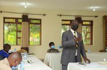 Mr Peter Sunday Rusoke, Minister of Culture, Tooro Kingdom, Kabarole speaks at meeting