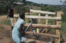 Ugandan schoolgirls using rehabilitated pump