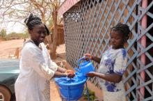 Women washing hands in Burkina Faso
