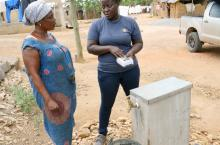 Rose Quaicoe, left, who has a household water connection at Wassa Edwenase discusses the services with Korkoe Aku Teyvi, Access