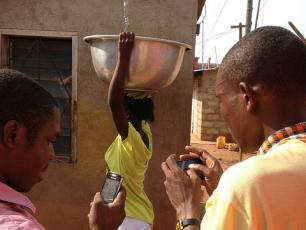 Monitoring water services using FLOW mobile phone technology