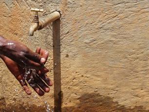 Washing hands under tap