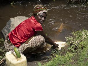 Fetching water from the river, Uganda