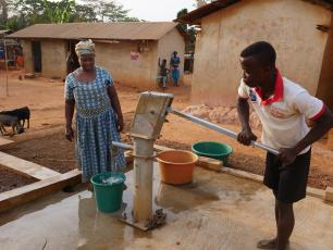 Janet Wilson collecting water close to her house in Agravi, Ghana