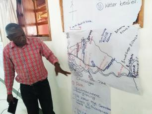 Explaining all the activities around river Mpanga (photo Arjen Naafs)