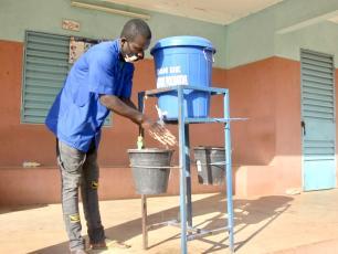 Nurse washing his hands at a health centre in Burkina Faso