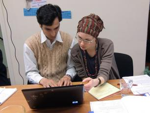 IRC colleague working with a colleague from RCN Nepal