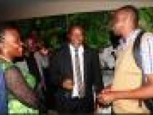 IRC Uganda's Lydia Mirembe chats with WASH Awards judge JB Wasswa at the gala