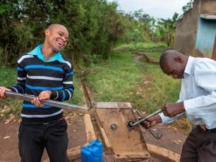 Baluku (left) and Stephen Baryebuga (right) Members of Kabarole HPMA at work
