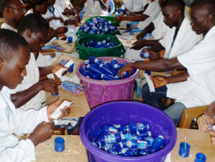 People making chlorine flasks at Tinkisso, Guinea Conakry