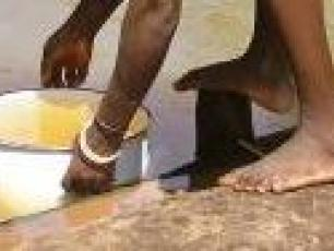 Woman collecting water in Africa