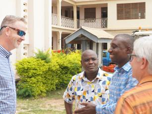 Ghana team with Hilton representatives