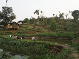 Villagers fishing in their newly expanded pond. Meghalaya, India