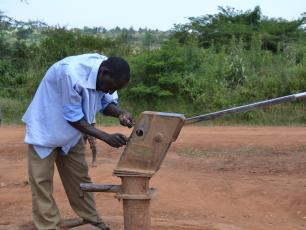 A hand pump mechanic at work in Namayingo District, Uganda