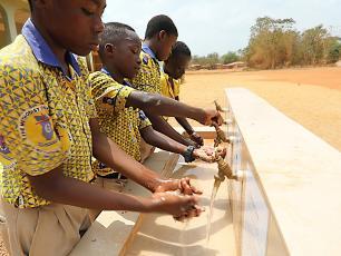 School children washing hands in Ghana