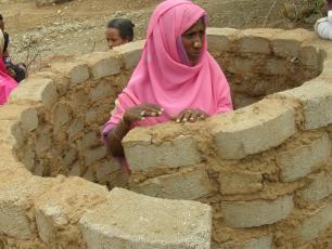 Woman constructing latrine in Wazinet village, Eritrea
