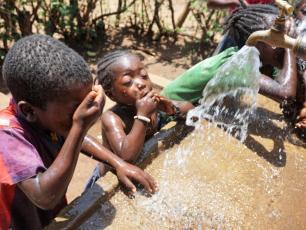 Happy children in Ethiopia enjoying water