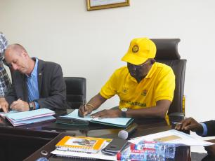 IRC CEO Patrick Moriarty, Minister of Sanitation and Water Resources Hon Joseph Kofi Adda sign MoU
