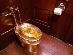 Golden toilet (photo by Leon Neal/Getty Images)