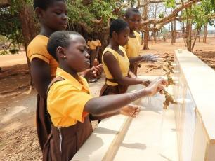 Girl children washing hands in a school in Ghana