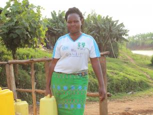 Harriet Burungu fetching water in Kabarole district