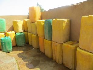 Stack of jerry cans for fetching water in Burkina Faso