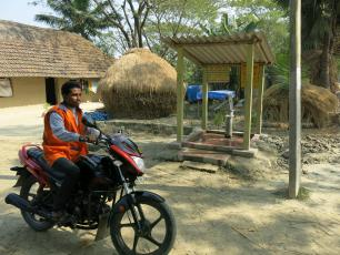 The Jalabandhu arrives at a handpump