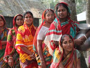 Bangladeshi women standing in line for water