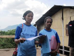 Ladies monitoring sanitation in Indonesian village