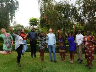 IRC staff jumping in the air